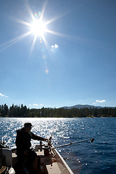 """Fishing on Lake Tahoe 2"" - This man was photographed fishing for Mackinaw near the West shore of Lake Tahoe, California."