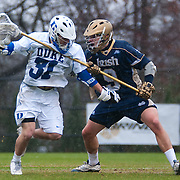 Duke attack Jordan Wolf #31 is guarded by Matt Miller Defense #9 . The third-ranked Fighting Irish defeated sixth-ranked Duke, 13-5, in men's lacrosse action on a snowy Saturday afternoon at Koskinen Stadium in Durham, N.C.