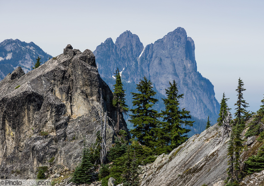Baring Mountain rises to 6127 feet (1868 meters) in the Central Cascades. Its sheer Northeast Face drops 3700 feet (1100 m) to Barclay Lake in only one-half mile. Hike the Beckler Peak Trail, 7.4 miles round trip with 2200 feet gain, in Mount Baker-Snoqualmie National Forest, Washington, USA. See vistas of  the town of Skykomish, Skykomish Valley, and Alpine Lakes, Wild Sky, and Henry M. Jackson Wilderness. Directions: Drive US Highway 2 to near Milepost 52, and turn north onto Forest Service Road 6066. Drive 6.6 miles on a gravel road to the Jennifer Dunn Trailhead.