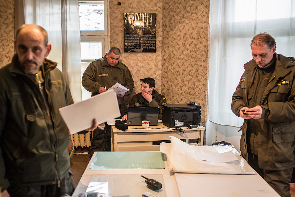 ARTEMIVSK, UKRAINE - FEBRUARY 14: Ukrainian soldiers meet inside an office on February 14, 2015 in Artemivsk, Ukraine. A ceasefire between Ukrainian forces and pro-Russian rebels is scheduled to go into effect at midnight. (Photo by Brendan Hoffman/Getty Images) *** Local Caption ***