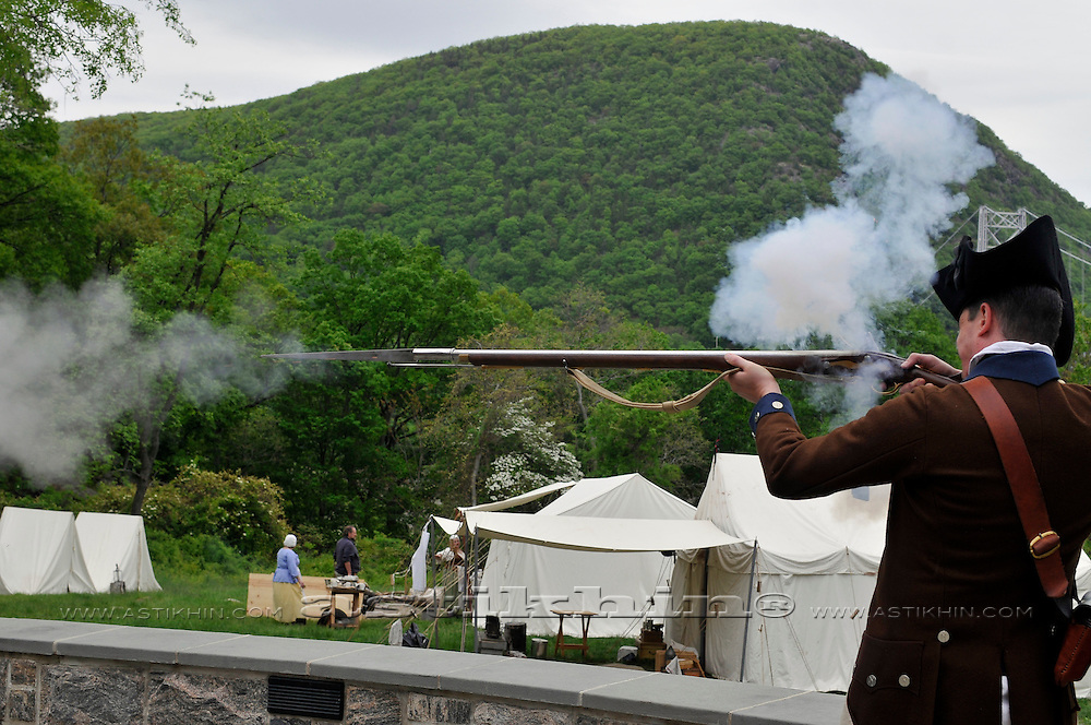 Soldier of American Revolution shooting Brown Bess musket in Fort Montgomery.
