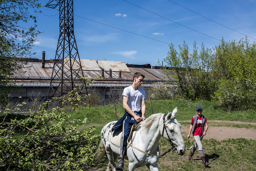 DONETSK, UKRAINE - APRIL 27: A man takes riding lessons next to the Donetsk Metallurgical Plant on April 27, 2014 in Donetsk, Ukraine. Pro-Russian activists have been occupying government buildings and demanding greater autonomy in at least ten Eastern Ukrainian cities in recent weeks, primarily in the Donetsk region, where much of the country's industry is centered. (Photo by Brendan Hoffman/Getty Images) *** Local Caption ***