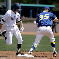UNCW's Steven Linkous is forced out at at firtst by Hofstra's Ryan Donovan. (Jason A. Frizzelle)