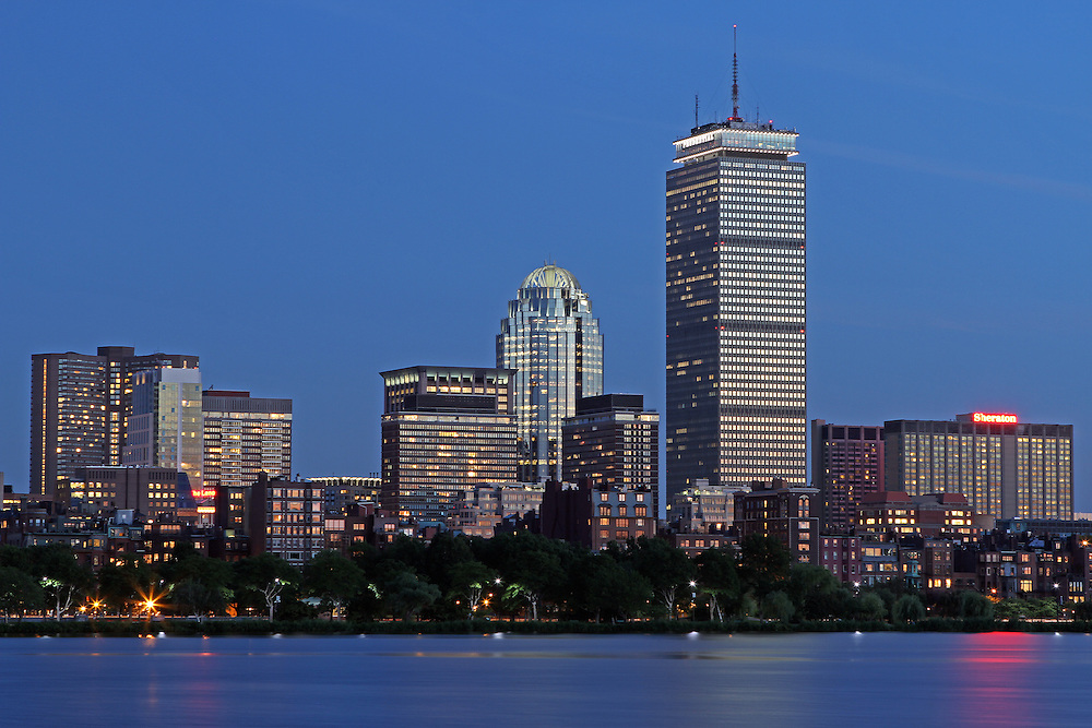 Boston skyline photography image showing the Boston Charles River skyline with its iconic Boston landmarks such as the Prudential Center and Brownstones on its banks.<br />