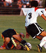 A Tampa Bay Rowdies player keeps his eye on the ball despite having trouble with his footing during an APSL soccer game against the Vancouver 86'ers in Vancouver, BC.<br />
