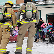 Ian Stewart/Yukon News<br /> Youngsters are evacuated from the Angel Falls Montessori Daycare in downtown Whitehorse on Thursday after smoke detectors went off. Firefighters searched the scene and found an overflowing washing machine on the second floor triggered the alarm.
