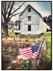 """An American flag at the Victory Garden at Strawbery Banke Museum in Portsmouth, New Hampshire. iPhone photo - suitable for print reproduction up to 8"""" x 12""""."""