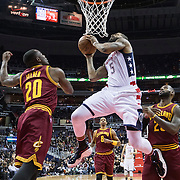 WASHINGTON, USA - November 11: Washington Wizard Markieff Morris (5) goes up for a shot against Cleveland Cavaliers LeBron James (23) and Kay Felder (20) at the Verizon Center in Washington, USA on November 11, 2016. Cleveland leads Washington 58-56 and half-time.