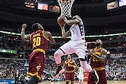 WASHINGTON, USA - November 11: Washington Wizard Markieff Morris (5) goes up for a shot against Cleveland Cavaliers LeBron James (23) and Kay Felder (20) at the Verizon Center in Washington, USA on November 11, 2016. Cleveland leads Washington 58-56 and half-time.