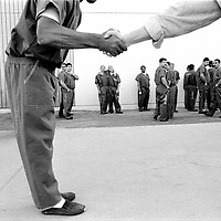 Huey Nguyen, right, a ex-con who frequents prisons preaching Christian salvation for Breakout Ministries as well as Bill Glass  Prison Ministry, greets inmates at Pitchess Honor Rancho, one of the ten different units that comprise the sprawling Los Angeles County Jail system which houses 21,000 inmates, the world's largest jail population.
