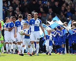 Bristol Rovers players emerge from the tunnel accompanied by their mascots - Mandatory by-line: Paul Knight/JMP - 23/04/2016 - FOOTBALL - Memorial Stadium - Bristol, England - Bristol Rovers v Exeter City - Sky Bet League Two