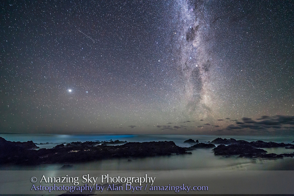 Jupiter and the southern Milky Way rising over the Tasman Sea, at Cape Conran, on the Gippsland Coast in Victoria, Australia. The Southern Cross and Coal Sack are at top right, with the Pointers of Alpha and Beta Centauri below. The dark lanes in the Milky Way form the head and neck of the Dark Emu, here rising out of the ocean in the southeast. Jupiter is the bright object at left. <br /> <br /> The waves below Jupiter may be blue from bioluminesence. <br /> <br /> This is a stack of 4 x 40-second exposures for the ground, mean combined to smooth noise and further blur the water, and one 4-second exposure for the sky, all with the 14mm Rokinon lens at f/2.5 and Canon 6D at ISO 3200.
