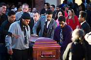 Turin Carter, center, and pallbearers wheel the casket of Tony Robinson, Jr. during Robinson's funeral at Madison East High School in Madison, Wisconsin, Saturday, March 14, 2015. Hundreds of people gathered on Saturday for the funeral of a 19-year-old man killed by a police officer in Wisconsin's capital on March 6, a shooting that prompted protests over law enforcement's treatment of minorities.  REUTERS/Ben Brewer (UNITED STATES)