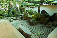 """Daisen-in is a sub-temple of Daitoku-ji of the Rinzai sect of Zen Buddhism, one of the five most important zen temples of Kyoto. The name means """"The Academy of the Great Immortals."""" Daisen-in was founded by the Zen priest Kogaku Soko and was built between 1509 and 1513.  Daisen-in is noted for its karesansui, or zen garden.  The garden was created in the eary 16h century and is attributed to the monk painter Soami. The main garden, is in an L shape.  It contains a miniature landscape similar to a Song Dynasty landscape painting, composed of rocks suggesting mountains and a waterfall, clipped shrubs and trees representing a forest, and raked white gravel representing a river. NOT AVAILABLE IN JAPAN - COMMERCIAL NOR EDITORIAL USAGE OF IMAGE"""