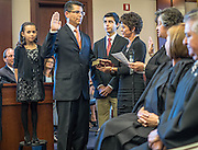 rer101813b/A1/10.18.13/Roberto E. Rosales<br /> Kenneth J. Gonzales(Cq),center, is sworn in as a United States District Judge for the District of New Mexico.  The oath was conducted by Chief Judge M. Chritina Armijo(Cq0, far right.  Standing with judge Gonzales are from left to right Abigail Gonzales(Cq), Alex Gonzales(Cq) and wife Jennifer Gonzales(Cq)<br /> Albuquerque, New Mexico(Albuquerque Journal)Roberto E. Rosales