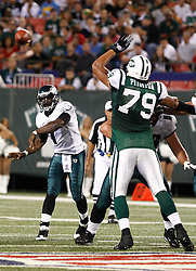 Sept 3, 2009; East Rutherford, NJ, USA;   Philadelphia Eagles quarterback Michael Vick (7) throws the ball past New York Jets defensive end Ropati Pitoitua (79) during the second half of the Eagles game against the New York Jets at Giants Stadium.  The Jets defeated the Eagles 38-27.