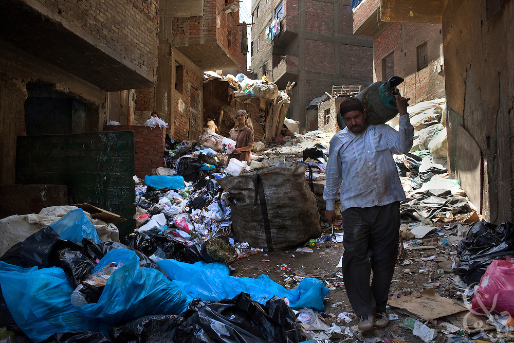 "Egyptian garbage collectors work in the Manshiyet Nasr neighborhood of Cairo, Egypt June 5, 2009. The majority coptic christian garbage collectors, known as ""zabbaleen"", (""garbage people"" in arabic), recently have had to adapt to a new way of working after the Egyptian government confiscated and killed all the pigs in their area. Pigs are important to the zabbaleen, since the pigs are used to dispose of all the organic bits of trash collected."