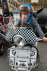 London, May 2nd 2015. Scores of scooter fanatics assemble in Carnaby Street for the annual Buckingham Palace Scooter Run that started life in the early eighties and was resurrected a few years ago by the New Untouchables and Bar Italia Scooter Club, with the run taking in many of the tourist hotspots in the capital before heading down the Mall towards Buckingham Palace.  PICTURED: Louie Howley, 3, from West Hampstead dreams of a scooter of his own when he's grown up.
