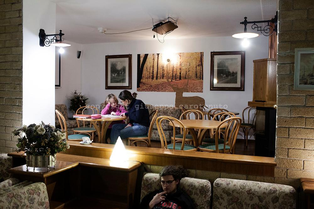 16 February 2017, Pescasseroli, AQ Italy - Tuourists in the hall of a Pescasseroli Hotel inside the National Park of Abruzzo.