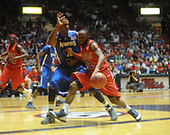 "Mississippi's Chris Warren vs. Memphis' Will Coleman in NIT second round basketball action at the C.M. ""Tad"" Smith Coliseum in Oxford, Miss. on Friday, March 19, 2010. Ole Miss won 90-81."