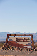 Furnace Creek Visitor Center sign and mountainscape - Death Valley National Park, California
