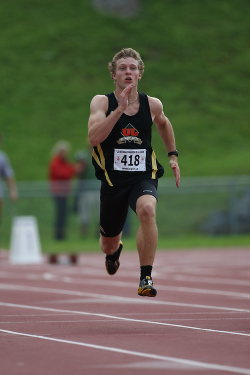 (Sherbrooke, Quebec---10 August 2008) Roc Lessard competing in the octathlon 100m at the 2008 Canadian National Youth and Royal Canadian Legion Track and Field Championships in Sherbrooke, Quebec. The photograph is copyright Sean Burges/Mundo Sport Images, 2008. More information can be found at www.msievents.com.