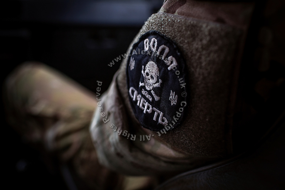 A patch on the arm of a volunteer drone pilot is saying: 'Freedom of Death', in Mariupol, southeast Ukraine.