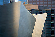 Early morning view of Walt Disney Concert Hall in downtown Los Angeles amidst downtown buildings