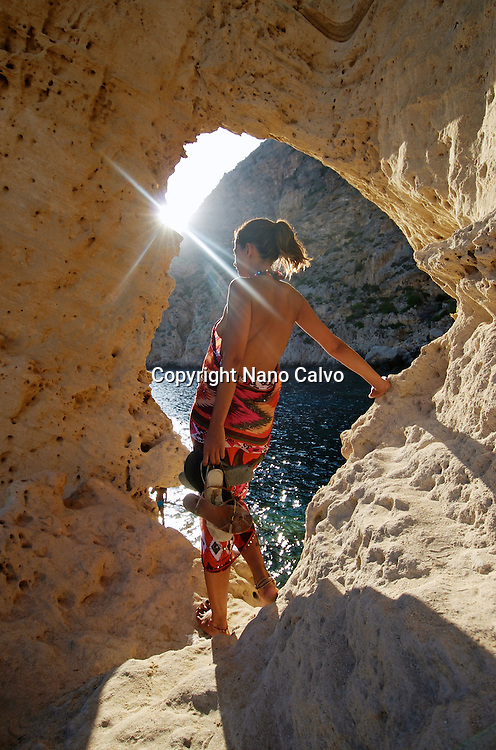 Young attractive woman in Atlantis, Sa Pedrera, Ibiza