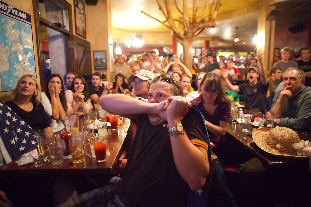 Nick Hess (front) and others at Conor O'Neill's pub in Boulder, Colorado react to a missed play by the US during the World Cup soccer match between England and the USA on June 12, 2010. The match ended in a 1-1 tie.