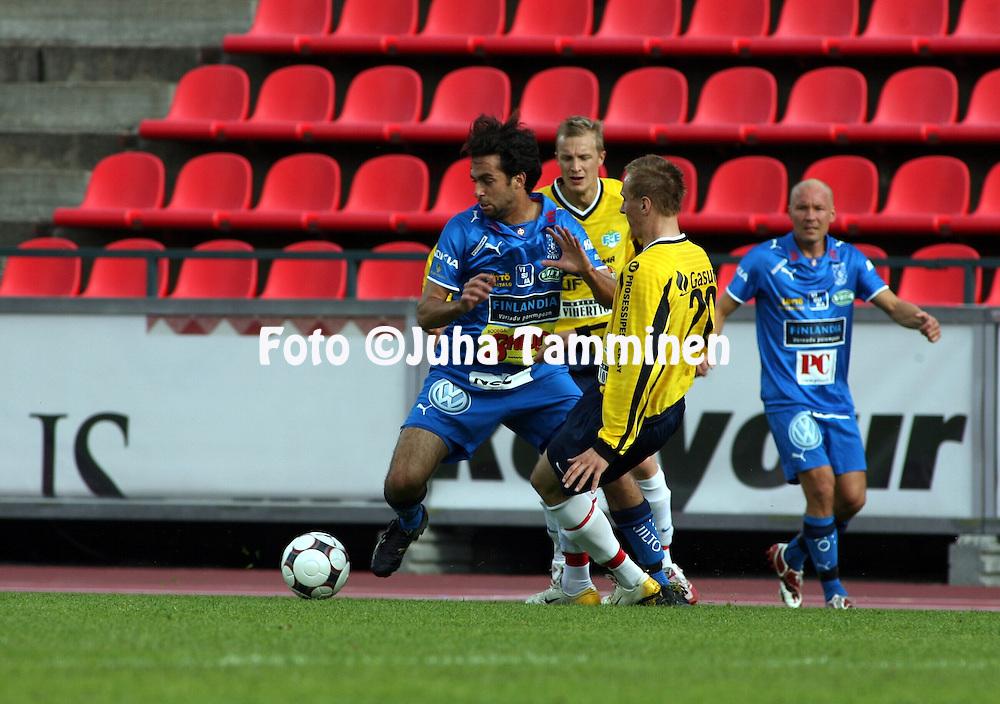 22.05.2008, Ratina, Tampere, Finland..Suomen Cup 2008 - Finnish Cup 2008.Tampere United - FC Espoo 2.Rafinha (TamU) v Henri Stigell (FC Espoo).©Juha Tamminen.....ARK:k