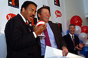 Boxing legend Muhammad Ali receives the Yum! Award from Yum! Brands chairman and CEO David Novak, Wednesday, March 26, 2003, in Louisville, Ky., as Yum! announces a $500,000 donation to the Muhammad Ali Center, scheduled to open in 2004. (Photo by Brian Bohannon)