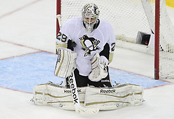 Mar 17; Newark, NJ, USA; Pittsburgh Penguins goalie Marc-Andre Fleury (29) makes a save during the first period of their game against  the New Jersey Devils at the Prudential Center.