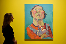 """© Licensed to London News Pictures. 25/04/2017. London, UK. A staff member views """"Untitled (Selbstportrait mit hasen) (Self portrait with rabbit)"""", 2003, by Maria Lassnig.  Launch of a new exhibition program at Sotheby's S