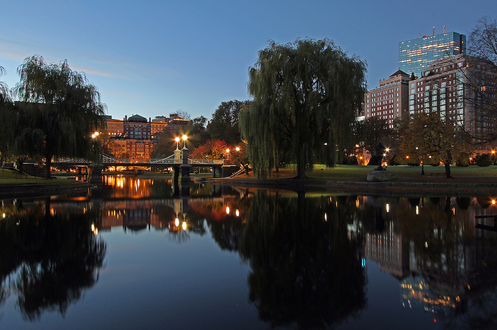 Buy a Print at http://juergen-roth.pixels.com/featured/boston-morning-show-juergen-roth.html<br /> <br /> Boston night photography of the historic Boston Public Garden Lagoon Bridge and John Hancock Tower photographed on a magical autumn morning in November.<br /> <br /> The bridge crossing the lagoon in the Boston Public Garden was designed by William G. Preston and opened in 1867. It was the shortest functioning suspension bridge in the world before its conversion to a girder bridge in 1921. Nowadays the original suspension system is purely decorative.<br /> <br /> This Boston fall foliage photography picture of the famous Boston Public Garden Lagoon Bridge is available as museum quality photography prints, canvas prints, acrylic prints or metal prints. Prints may be framed and matted to the individual liking and decorating needs.<br /> <br /> All photographs are available framed, matted or print only on metal, acrylic, canvas or standard photo prints at <br /> <br /> http://juergen-roth.pixels.com/featured/boston-morning-show-juergen-roth.html<br /> <br /> <br /> Good light and happy photo making! <br /> <br /> Juergen <br /> www.RothGalleries.com <br /> www.ExploringTheLight.com<br /> http://whereintheworldisjuergen.blogspot.com<br /> @NatureFineArt<br /> https://www.facebook.com/naturefineart
