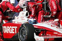 Scott Dixon pits at the Michigan International Speedway, Firestone Indy 400, July 31, 2005