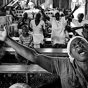 The number of cholera victims in CitÈ Soleil, a slum of Port-au-Prince, is increasing day by day exponentially, according to a doctor of Doctors Without Borders, esentially because of hygienic problems.///People pray in a church made with sheet metal, in the slum of Cite Soleil in Port-au-Prince.