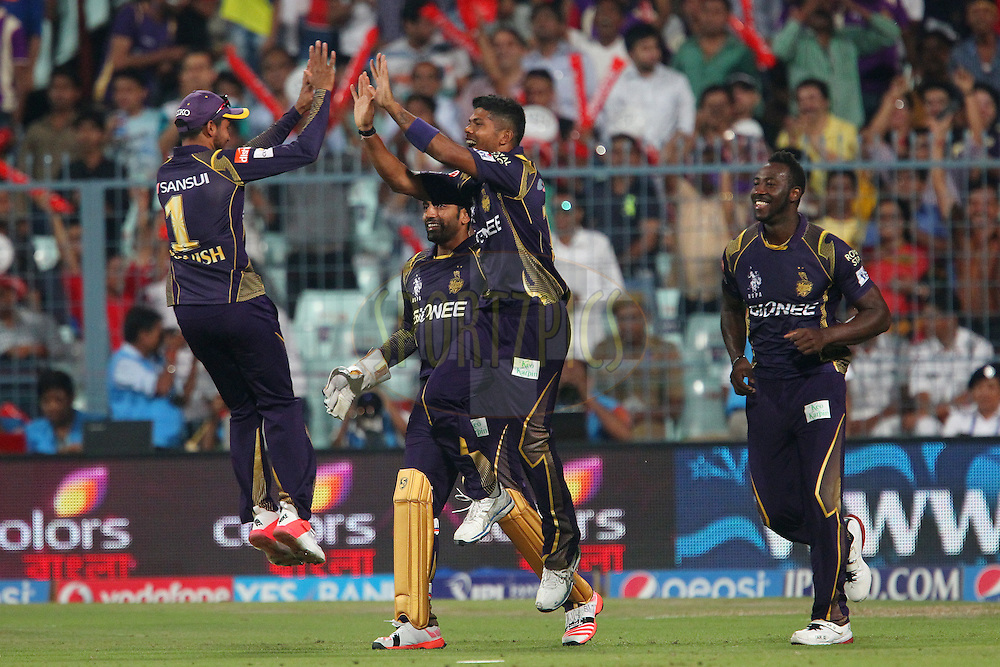 Umesh Yadav of the Kolkata Knight Riders  celebrates the wicket of Aaron Finch of the Mumbai Indians  during match 1 of the Pepsi IPL 2015 (Indian Premier League) between The Kolkata Knight Riders and The Mumbai Indians held at Eden Gardens Stadium in Kolkata, India on the 8th April 2015.<br /> <br /> Photo by:  Ron Gaunt / SPORTZPICS / IPL