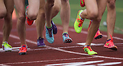 Fluorescent shoes fly in the Girls 3A 800M Run during the State Track and Field Championships at Mount Tahoma High School in Tacoma on Saturday, May 28, 2016. (Lindsey Wasson / The Seattle Times)