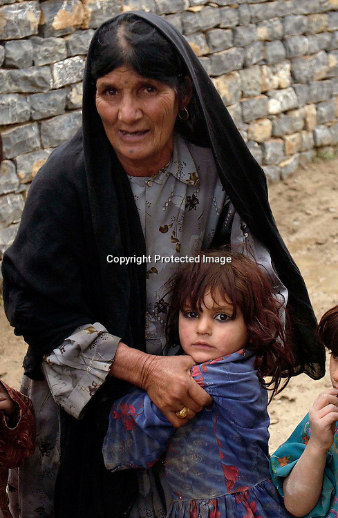 Bibi Mastan holds Bibi Rashida(3),  the daughter  of her son Diliwar at their home in the the town of Yakubi in the district of Khost, Afghanistan May 2, 2005. Diliwar, a 22-year-old farmer and part-time taxi driver, died in December 2002 while being held in the main United States air base at Bagram, north of Kabul. His death was ruled a homicide by the Army medical examiner.<br />