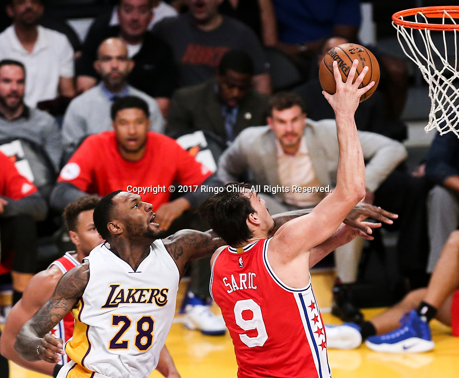 Philadelphia 76ers forward Dario Saric (#9) gets fouled by Los Angeles Lakers center Tarik Black (#28) during an NBA basketball game Tuesday, March 12, 2017, in Los Angeles. <br /> (Photo by Ringo Chiu/PHOTOFORMULA.com)<br /> <br /> Usage Notes: This content is intended for editorial use only. For other uses, additional clearances may be required.