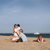 Family portrait on the beach. Husband and wife with three lovely children captured in serene photographs while playing and enjoying their day at Capella Pedregal beach in Cabo San Lucas, Baja California Sur, Mexico.