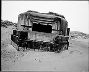 THE ATLANTIC WALL. .pic shows: BUNKERS FALLEN ONTO THE SANDS AT BLERIOT-PLAGE, CALAIS..WORLD WAR TWO ENDED IN EUROPE IN MAY 1945, THIS YEAR SEES THE 60th ANNIVERSARY OF THAT VICTORY..THE ATLANTIC WALL BUILT BY GERMANY IN WORLD WAR 2 STRETCHED FROM NORWAY VIA DENMARK, HOLLAND, BELGIUM AND FRANCE TO THE SPANISH BORDER. THE MAIN CONCENTRATION OF BUNKERS,BLOCKHOUSES AND DEFENCES WERE ALONG THE DUTCH, BELGIAN AND FRENCH COASTAL AREAS MOST UNDER THREAT FROM AN ALLIED INVASION. THE CONSTRUCTION OF THE WALL BEGAN IN 1942 AND CONTINUED UP UNTIL THE JUNE 6th ALLIED INVASION ON D-DAY IN 1944..TENS OF THOUSANDS OF WORKERS AND PRISONERS FROM THE GERMAN OCCUPIED AREAS OF EUROPE WERE EMPLOYED BY THE ORGANISATION TODT NAMED AFTER FRITZ TODT, THE GERMAN ENGINEER WHO DIED IN 1942 (TO BE SUCEEDED BY ALBERT SPEER) IN THE BUILDING WORK. BETWEEN THE RIVERS LOIRE AND DIVES 87,257 WORKERS WERE USED INCLUDING 55,000 FRENCHMEN, 11,500 GERMANS, 4,200 DUTCH, 6.600 BELGIANS, 2,600 NORTH AFRICANS AND SEVERAL THOUSAND FROM EASTERN EUROPE..THE ATLANTIC WALL WAS THE LARGEST BUILDING PROJECT SINCE THE ROMAN EMPIRE. MANY OF THE COLOSSAL GUN BUNKERS AND UNDERGROUND DEFENSIVE CHAMBERS REMAIN. SOME HAVE FALLEN FROM CLIFF TOP POSITIONS WHILE OTHERS ARE PARTLY CONSUMED BY SAND DUNES. THE RAVAGES OF WAR, TEN THOUSAND TON BOMBS AND 60 YEARS OF COASTAL WEATHER HAVE HARDLY AFFECTED THESE LEVIATHAN LIKE STRUCTURES WHICH LOOK LIKELY TO LAST AS LONG AS THE RUINS OF ANCIENT ROME. A FITTING REMINDER OF A WORLD THAT COULD HAVE BEEN FROM 60 YEARS AGO..COPYRIGHT PHOTOGRAPH BY BRIAN HARRIS  © 2005.07808-579804