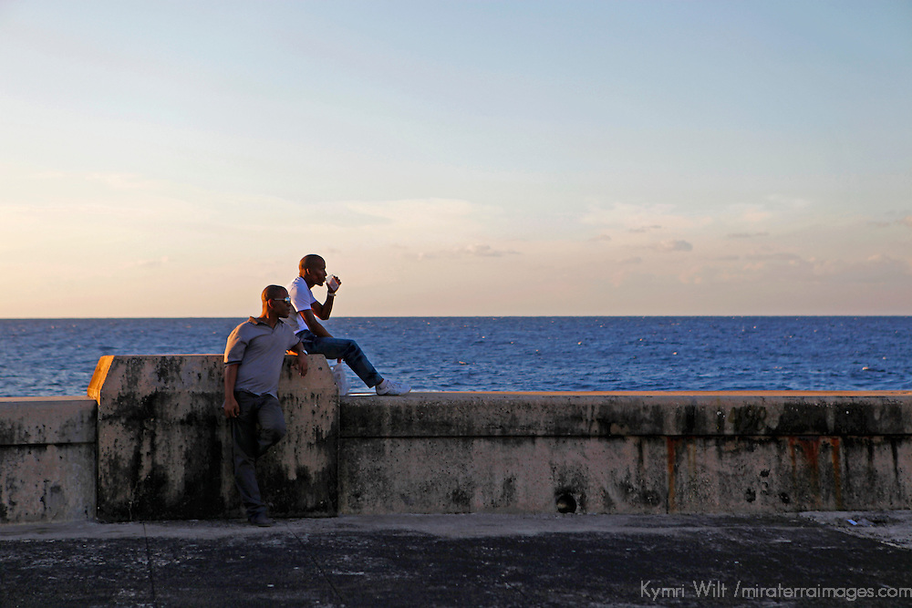 Central America, Cuba, Havana.  Cubans on the Malecon, Havana.