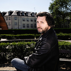 """French director Bruno Podalydes at the square des Francines where he shot his last movie """"Les bancs publics"""". Versailles, France. May 29, 2009. Photo: Antoine Doyen"""