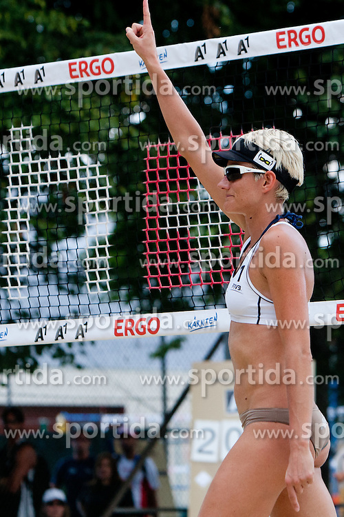 Andreja Vodeb of Slovenia celebrates victory and qualification to main draw at A1 Beach Volleyball Grand Slam presented by ERGO tournament of Swatch FIVB World Tour 2012, on July 17, 2012 in Klagenfurt, Austria. (Photo by Matic Klansek Velej / Sportida)