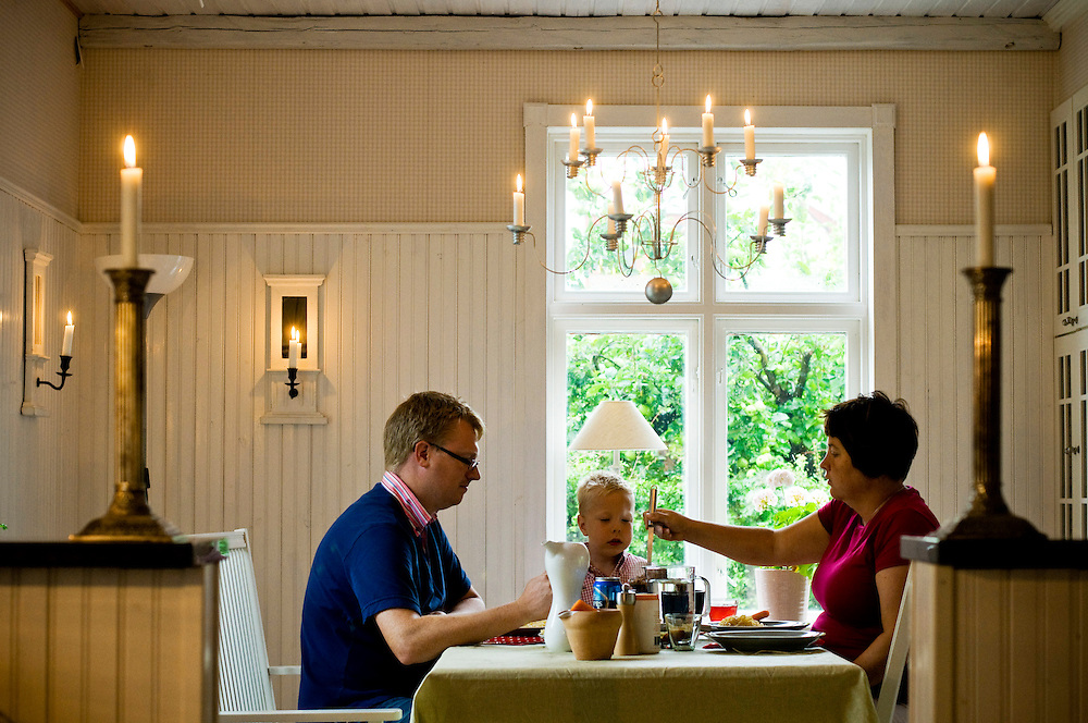 Måns Persson and Pernilla Cederlund with their son Julius, 4, having lunch in the kitchen  on a rainy day in their summer house in Vitaby, Skåne