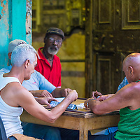 HAVANA, CUBA - JULY 18 : Unidentified men play dominos on the street on July 18 2016 in Havana , Cuba. Domino is one of the most popular games in Cuba