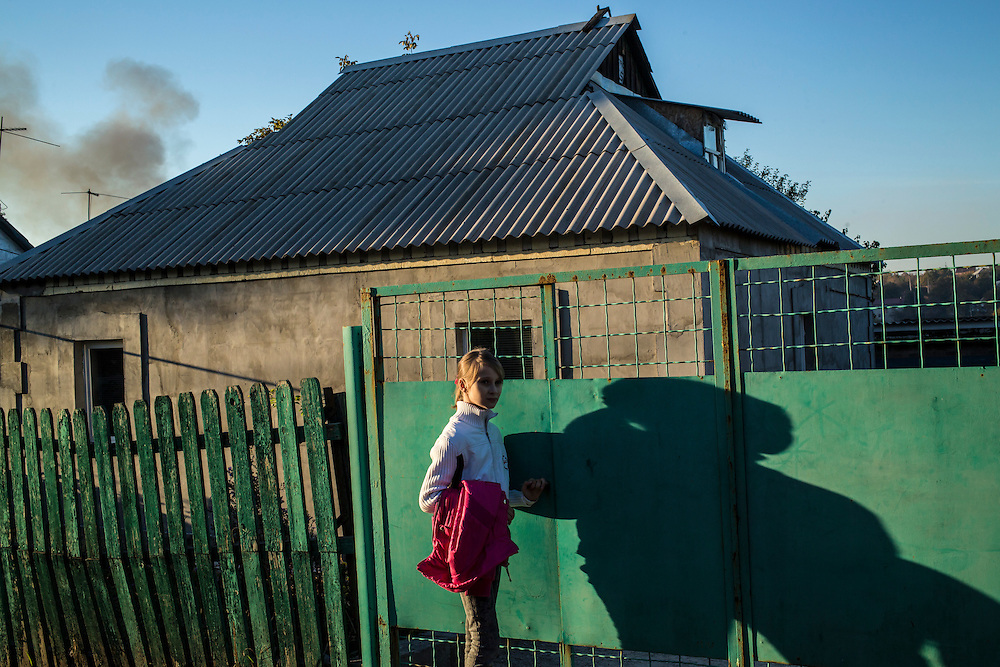 DNIPROPETROVSK, UKRAINE - OCTOBER 12: Yeva, 10, after a long trip from the Good News Evangelical Church, arrives at the home in the Krasnopillia district where she, her mother, and her grandmother are living with a family that is part of the church's congregation on October 12, 2014 in Dnipropetrovsk, Ukraine. Yeva and her family fled fighting in Luhansk. The United Nations has registered more than 360,000 people who have been forced to leave their homes due to fighting in the East, though the true number is believed to be much higher.(Photo by Brendan Hoffman/Getty Images) *** Local Caption ***