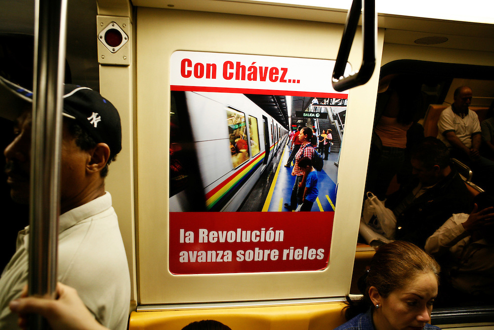 """With Chavez ... the revolution advances on rails"" reads a sign in the public subway. Riders pay roughly $.10 per ticket."